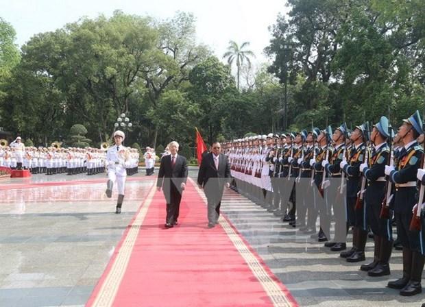 老挝人民革命党中央总书记、国家主席本扬·沃拉吉开始对越南进行正式友好访问 hinh anh 1