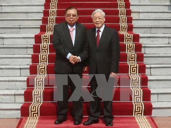 老挝人民革命党中央总书记圆满结束对越南的正式友好访问 hinh anh 1