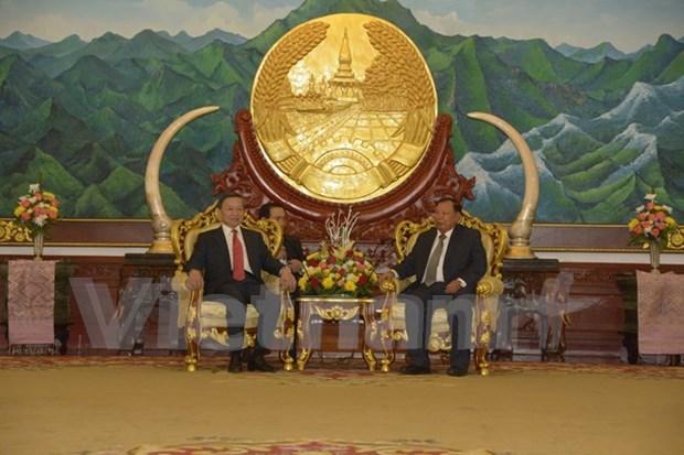 越南公安部高级代表团访问老挝 hinh anh 1