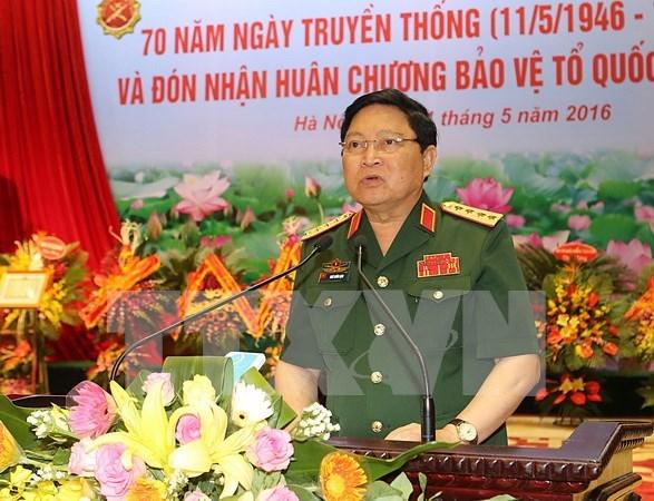 越南人民军队高级军事代表团访问老挝 hinh anh 1
