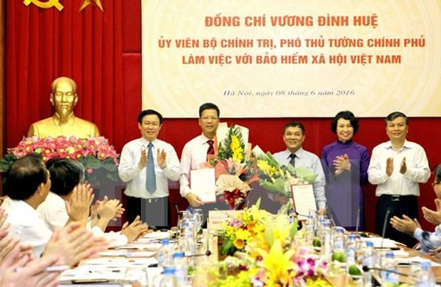 王廷惠副总理:社会保险和医疗保险是越南社会保障制度的两大支柱 hinh anh 1