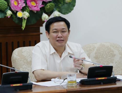 王廷惠副总理:越南存款保险公司应积极参与银行结构调整过程 hinh anh 1
