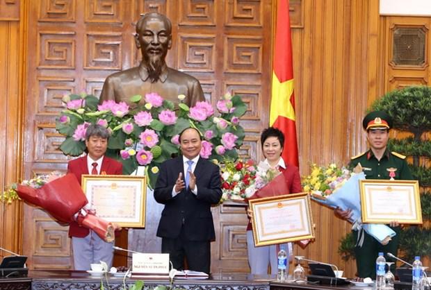 越南政府总理阮春福会见参加2016年里约奥运会的越南体育代表团 hinh anh 1