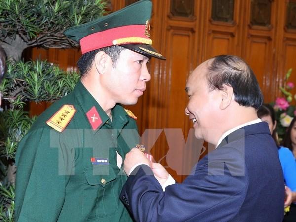 越南射击选手黄春荣荣获一级劳动勋章 hinh anh 1