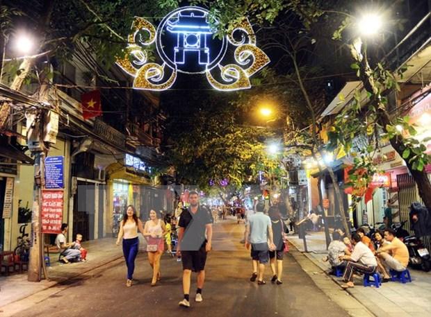越南河内市与法国图卢兹市合作关系20周年展在河内举行 hinh anh 1
