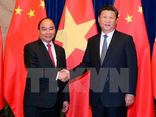 中国媒体密集报道越南政府总理阮春福访华之旅 hinh anh 1