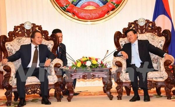张明俊部长拜会老挝政府总理通伦•西苏里 hinh anh 1