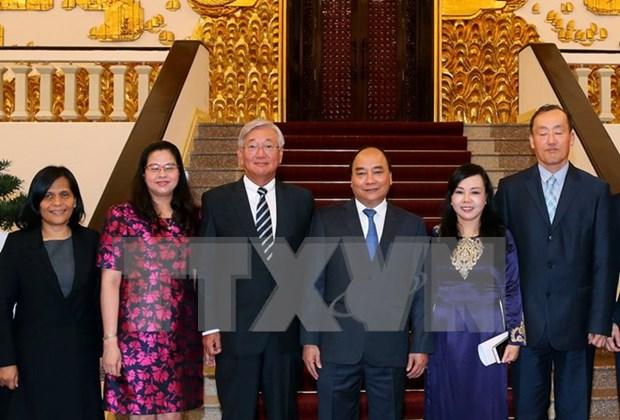 越南政府总理阮春福会见世界卫生组织西太平洋地区办公室主任 hinh anh 1