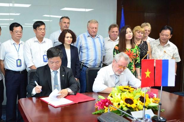 越南电力工会与俄罗斯电力工会签署合作协议 hinh anh 1
