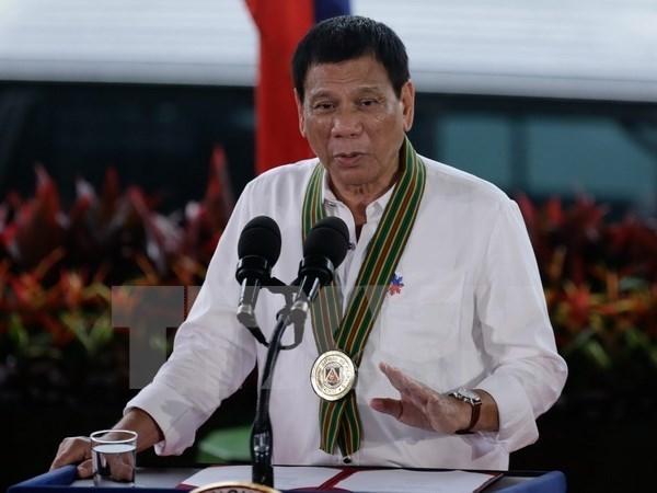 菲律宾承诺不会搁置海牙仲裁庭的最终裁决 hinh anh 1
