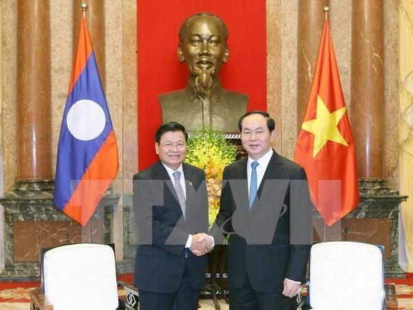 越南国家主席陈大光:致力促进越老互联互通重大项目全面开展 hinh anh 1
