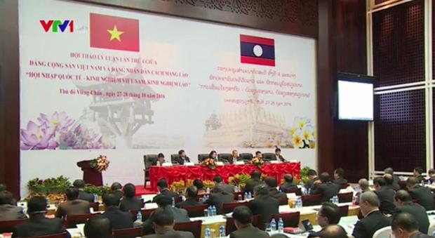 越南共产党与老挝人民革命党第四次理论研讨会在万象举行 hinh anh 1