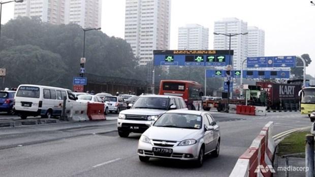 马来西亚开始征收外国车辆入境费 hinh anh 1