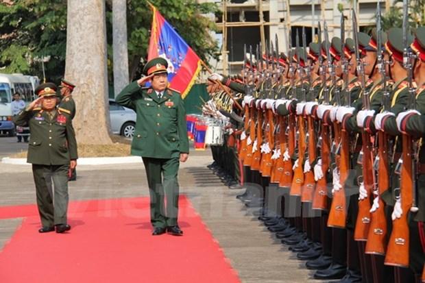 越老两国国防部签署2016年合作计划 hinh anh 1