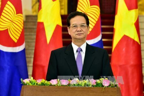越南政府总理阮晋勇:越南欢迎东盟共同体正式建成 hinh anh 1