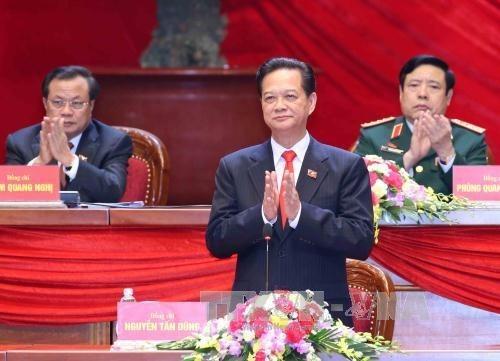 越共十二大发表开幕式的新闻公报 hinh anh 2