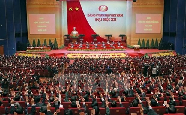 老挝、中国共产党等向越共十二大致贺电的内容 hinh anh 1