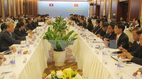 越老边境工作代表团第25次年度会议在岘港市召开 hinh anh 1