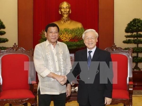 越共中央总书记阮富仲会见菲律宾总统杜特尔特 hinh anh 1