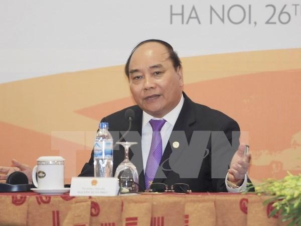 越南政府总理阮春福在河内举行国际新闻发布会 hinh anh 1