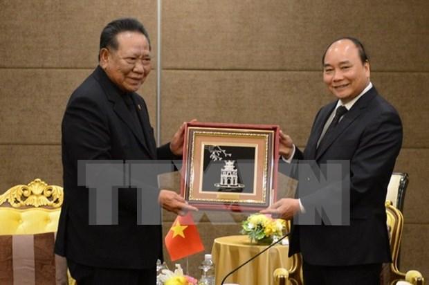 越南政府总理阮春福会见泰越友好人士和泰国企业领导代表 hinh anh 1
