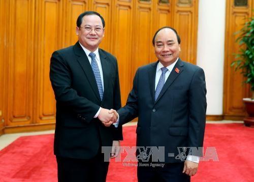 政府总理阮春福会见老挝副总理宋赛·西潘敦 hinh anh 1