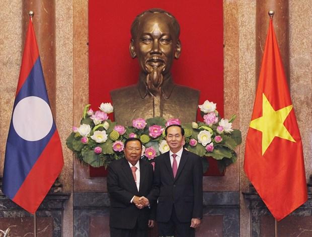 老挝人民革命党中央总书记、国家主席本扬·沃拉吉访问越南 hinh anh 2