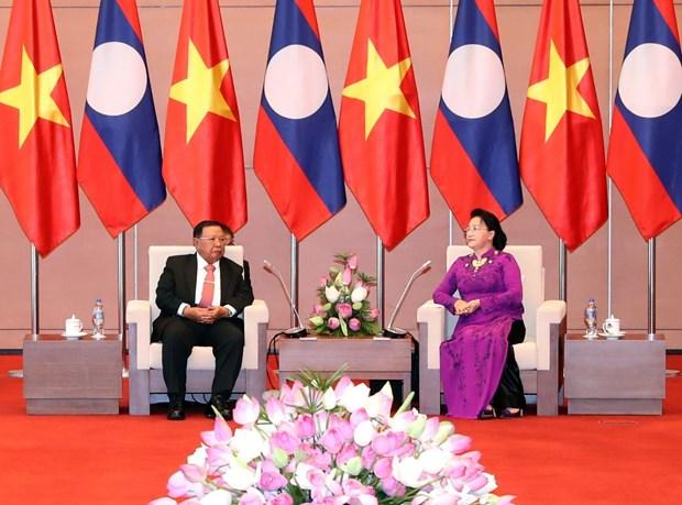 老挝人民革命党中央总书记、国家主席本扬·沃拉吉访问越南 hinh anh 3