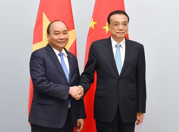 ASEM 12: 阮春福总理会见中国国务院总理李克强 hinh anh 1