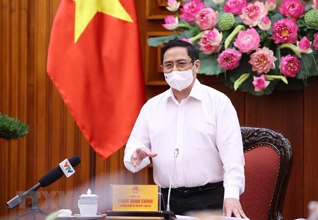 越南政府总理范明政:研究建立新冠疫苗基金 hinh anh 1
