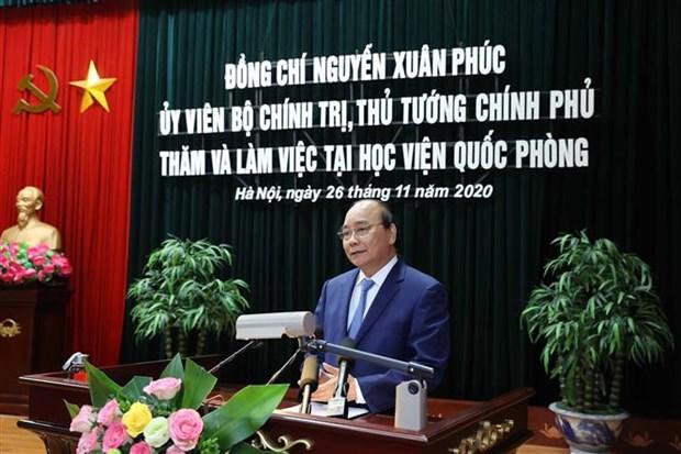 越南政府总理阮春福造访越南国防学院 hinh anh 1