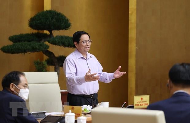 范明政总理:防疫成果不是天上掉下来的 hinh anh 1