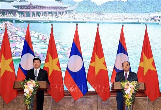 越老两国总理在两国政府间联合委员会第42次会议后共同会见记者 hinh anh 1