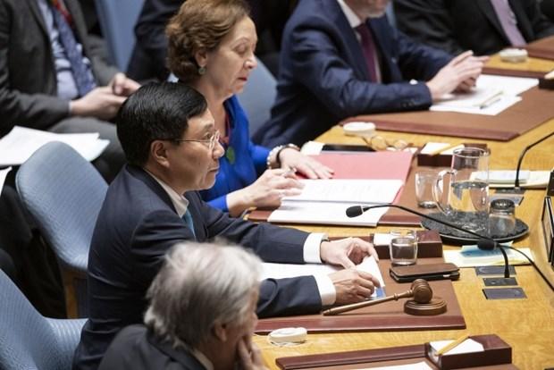 越南与联合国安理会:政府副总理兼外长范平明主持公开辩论会 hinh anh 1