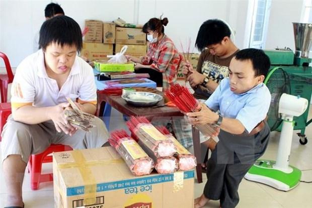 越南橙剂灾害60周年:携手抚平战争创伤 hinh anh 1