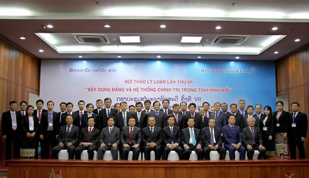 越南共产党与老挝人民革命党第七次理论研讨会开幕 hinh anh 2