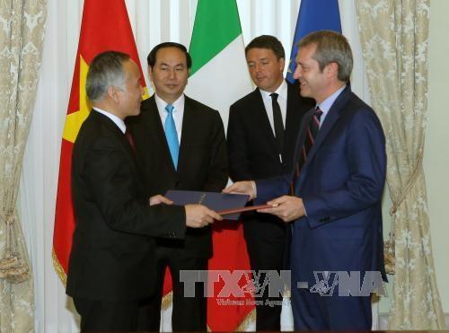 越南国家主席陈大光会见意大利总理马泰奥•伦齐 hinh anh 2