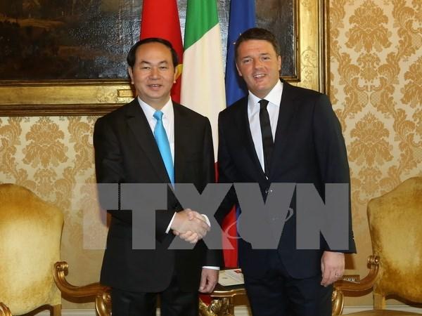 越南国家主席陈大光会见意大利总理马泰奥•伦齐 hinh anh 1