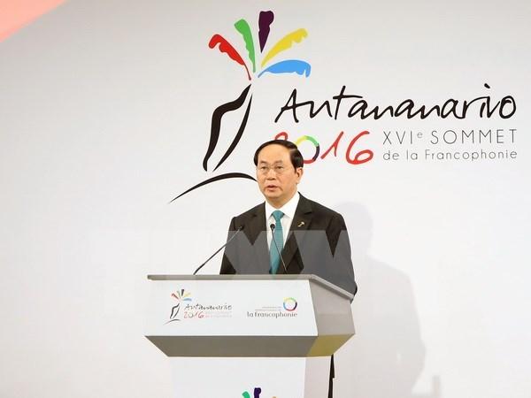 越南国家主席陈大光出席第16届法语国家组织峰会的活动报道 hinh anh 1