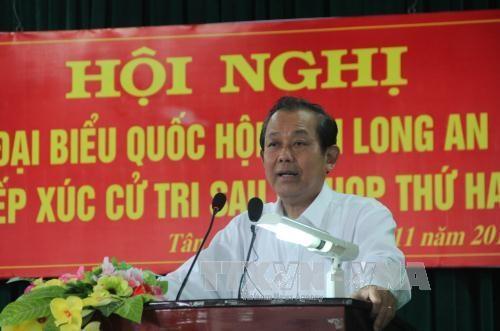 越南党及国家领导纷纷开展与各地选民接触活动 hinh anh 2