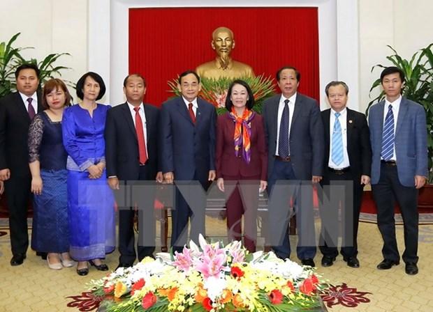 越共中央民运部部长张氏梅会见柬埔寨人民党中央外委会代表团 hinh anh 1
