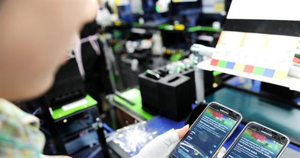 今年前11个月越南的手机及零件出口额达310亿美元 hinh anh 1