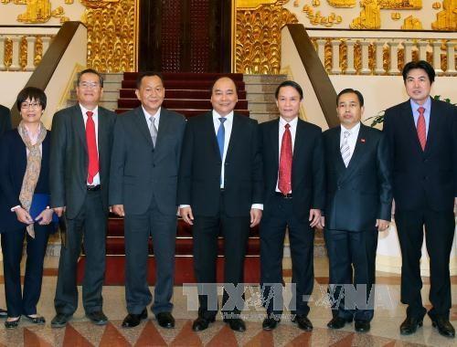 越南政府总理会见老挝巴特寮通讯社社长 hinh anh 2