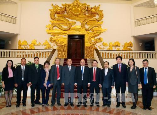 越南政府总理会见老挝巴特寮通讯社社长 hinh anh 1