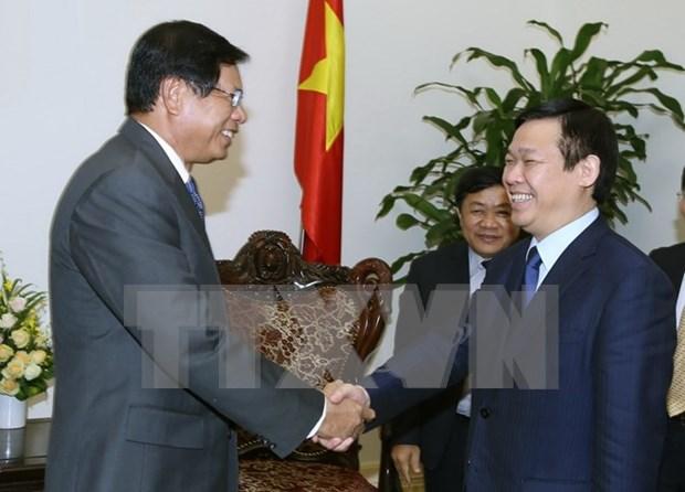 政府副总理王廷惠:越南支持与老挝促进研究经济政策的合作 hinh anh 1