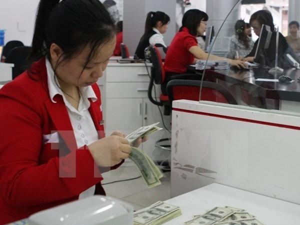 越南胡志明市侨汇收入比年初计划降低10% hinh anh 1