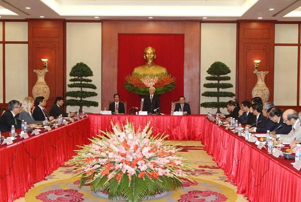 阮富仲总书记会见第五次越南学国际学术研讨会与会代表 hinh anh 1