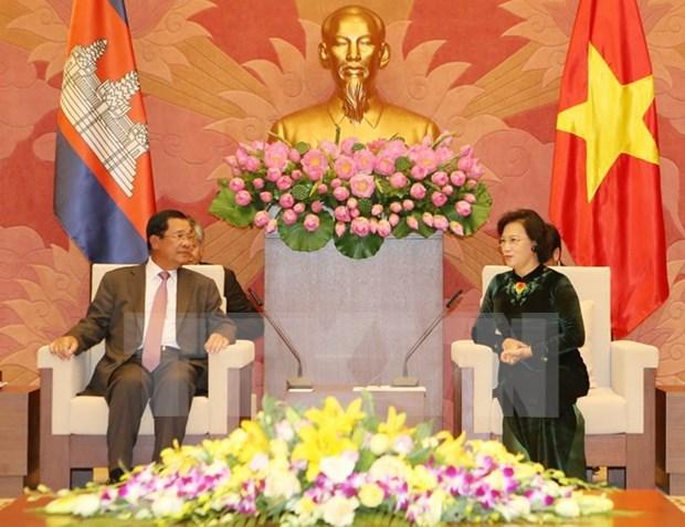 国家主席陈大光与国会主席阮氏金银分别会见柬埔寨首相洪森 hinh anh 2