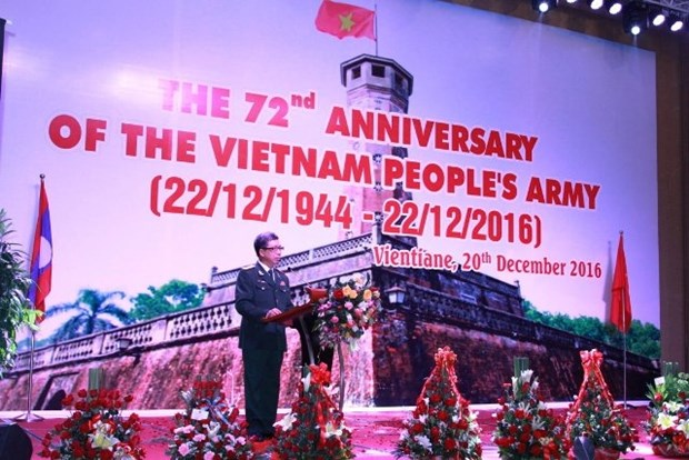 越南人民军建军72周年纪念仪式在老挝举行 hinh anh 1