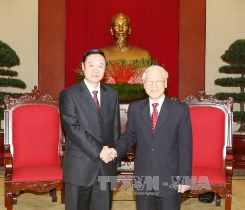 越共中央总书记阮富仲会见中国共产党代表团 hinh anh 1
